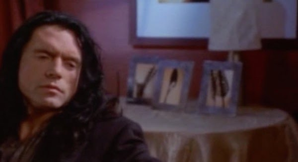 tommy-wiseau-sits-in-front-of-some-spoons